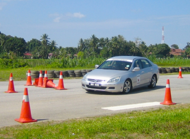 How important is defensive driving on Malaysian roads?